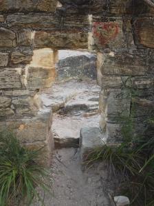 Through the stone wall
